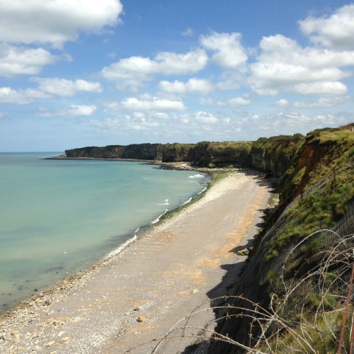 The view from Pointe du Hoc, complete with barbed wire